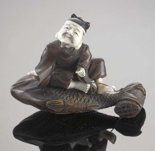 A boxwood and ivory netsuke of