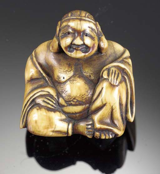 A stained ivory netsuke of Hot