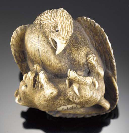 A stained ivory netsuke of an