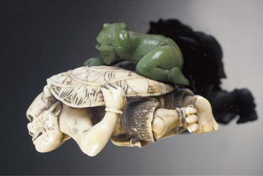 A stained netsuke of two oni 1