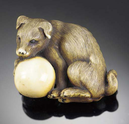 A stained ivory netsuke of a h