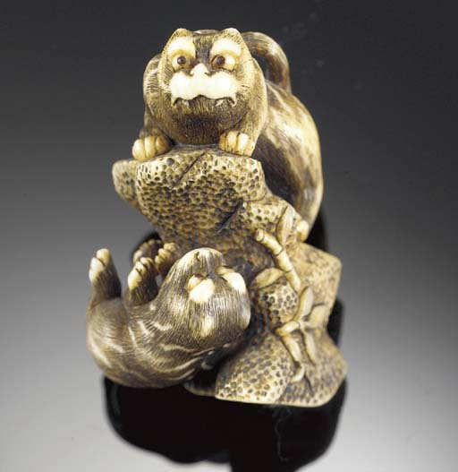 A stained ivory netsuke of two