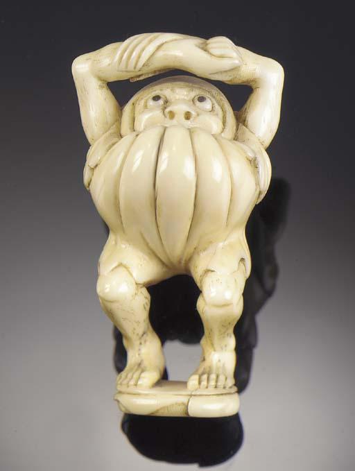 An ivory netsuke of a mythical