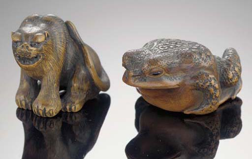 A wood netsuke of a toad 19th