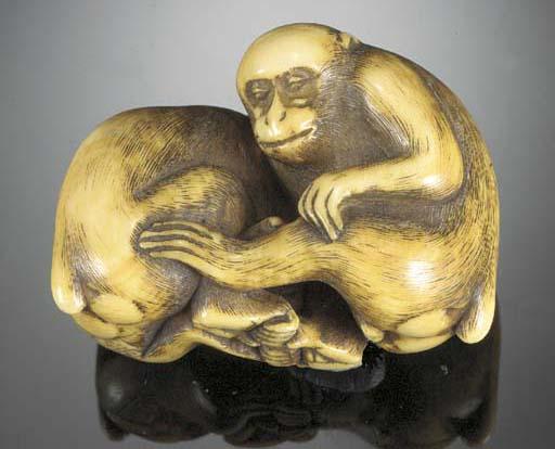 An ivory netsuke of two monkey