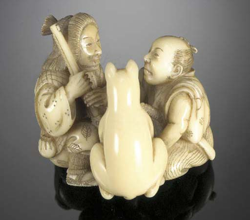 An ivory netsuke of a fox and