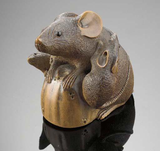 A boxwood okimono of a rat and