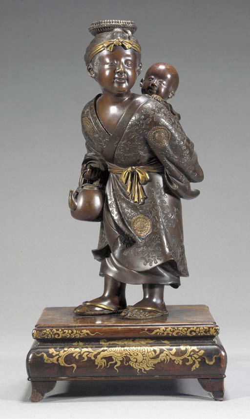 A gilt bronze okimono of a mot