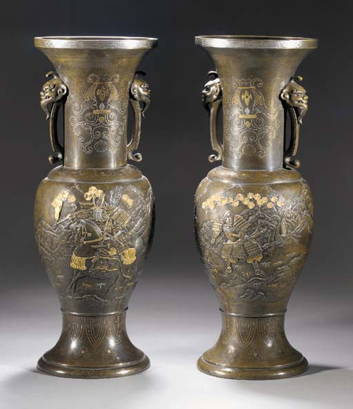 A large pair of inlaid bronze