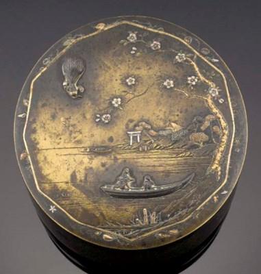 A bronze inlaid circular box a