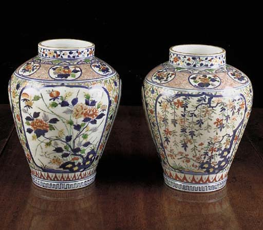 A pair of Arita baluster jars