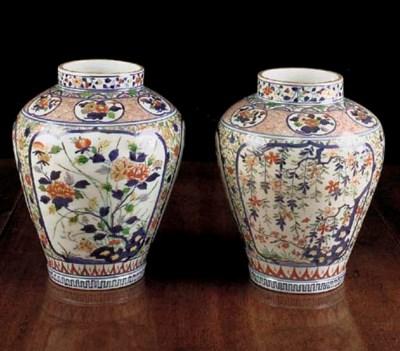 A pair of Arita baluster jars