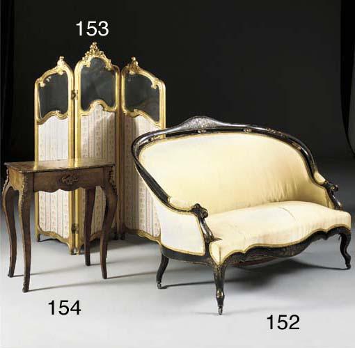 A Napoleon III ebonised sofa