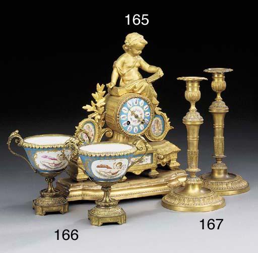 A pair of Louis XVI ormolu can