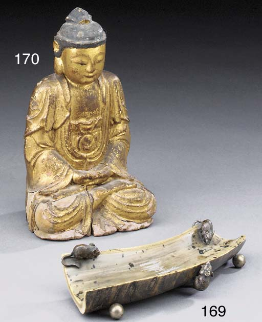 A giltwood model of a seated b