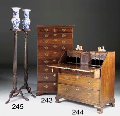 A pair of mahogany urn stands