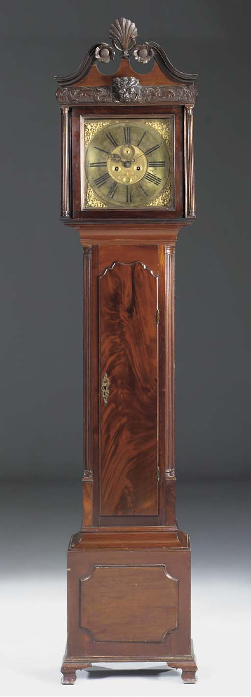 An Irish mahogany longcase clo