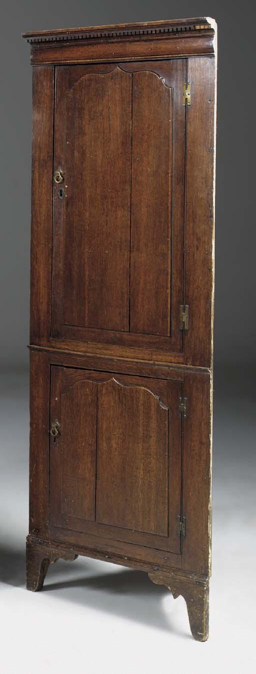 An oak standing corner cabinet