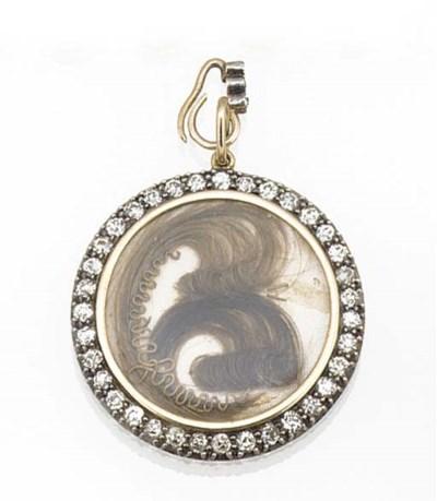 An antique diamond set locket