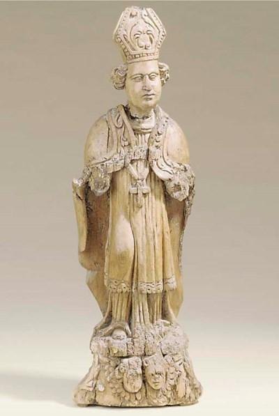 A Flemish carved elm figure of