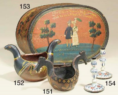 A pair of polychrome wood and