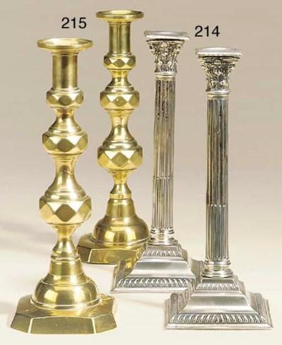 A pair of Paktong candlesticks