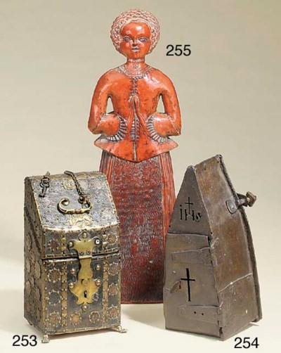 A red wax effigy of a woman