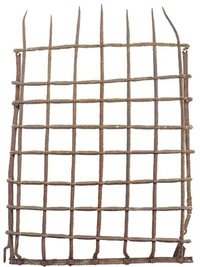 A wrought iron lattice window