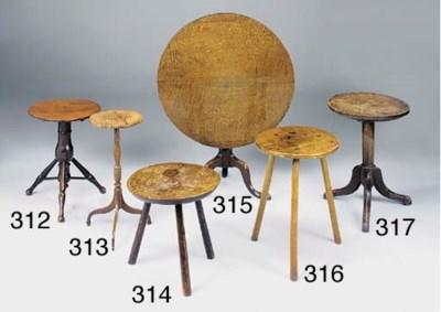 A FIGURED ELM CRICKET TABLE, E