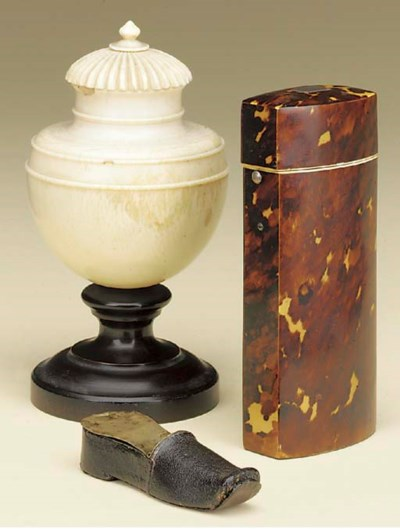 A turned ivory urn and cover,