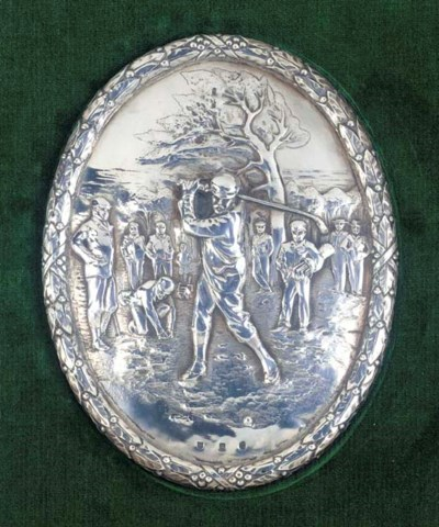 AN OVAL SILVER GOLFING PLAQUE