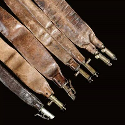 FIVE LEATHER SHOT BELTS, A GRO