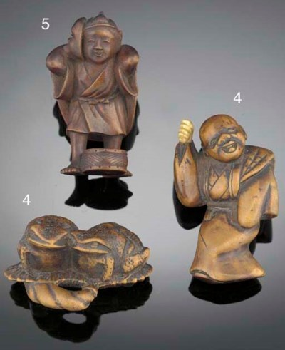 A Japanese wood netsuke of a d