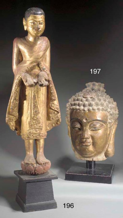 A CHINESE GILT STUCCO HEAD OF