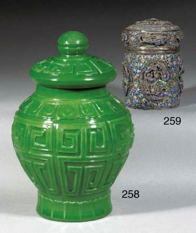A CHINESE GREEN GLASS BALUSTER