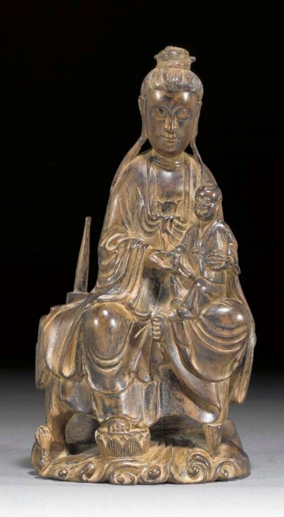 A CHINESE WOODEN FIGURE OF GUA