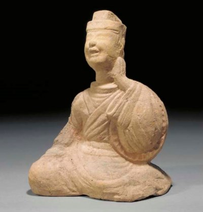A HAN RED POTTERY MODEL OF AN