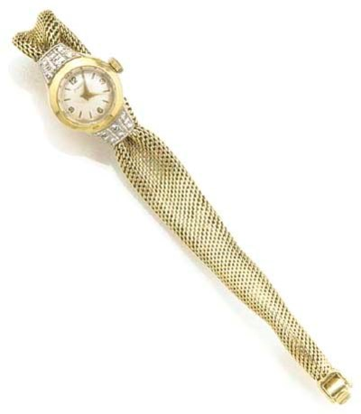 PIAGET, A LADY'S 14ct. GOLD DI