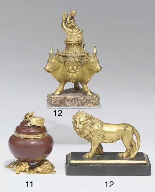A gilt bronze model of a lion,