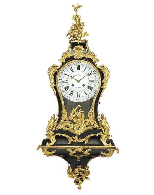 A Louis XV ebonised wood and o
