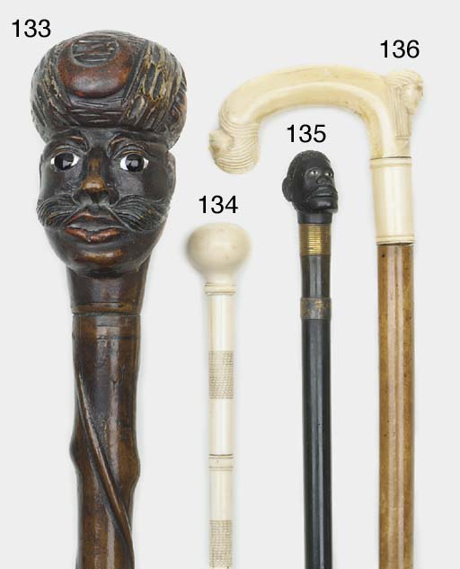 A French carved ebony and horn