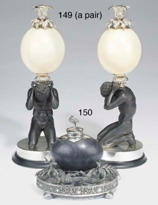 A pair of white metal, ostrich