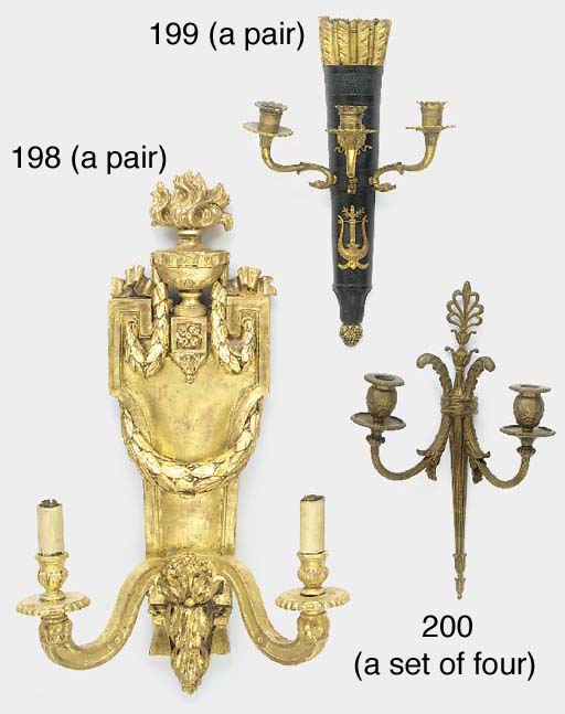 A PAIR OF CARVED GILT-WOOD TWI