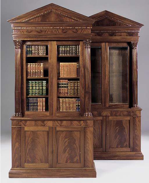 A PAIR OF MAHOGANY OPEN BOOKCA