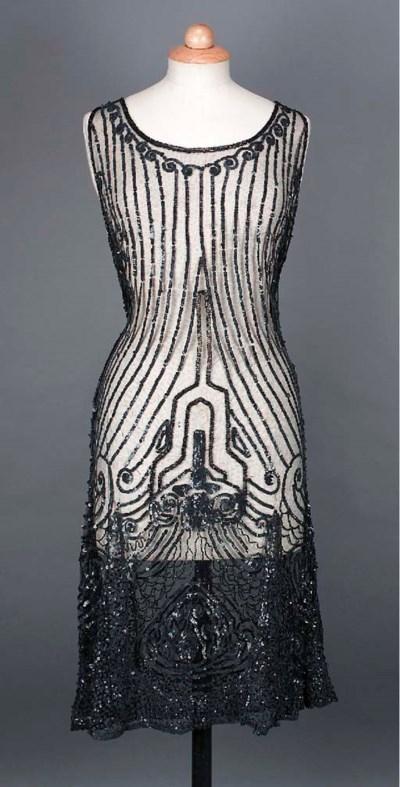 A cocktail dress of black net,