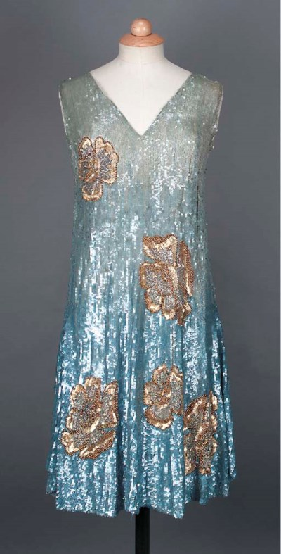 A cocktail dress, encrusted wi