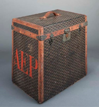 A Goyard hat trunk, covered in