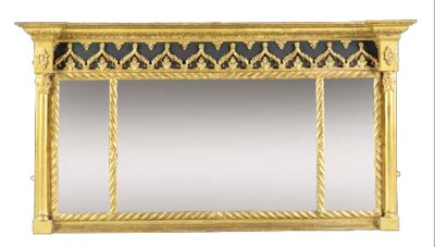 An ebonised giltwood and compo