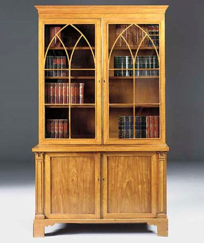 A satinwood and mahogany bookc
