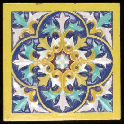 A MAJOLICA TILE designed by A